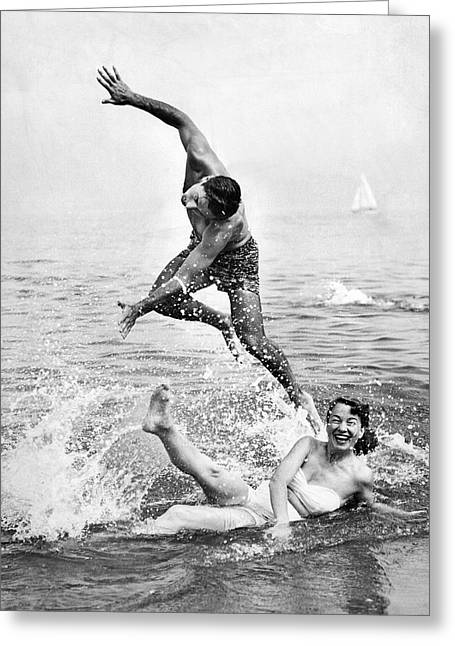 Couple Frolics In The Surf Greeting Card by Underwood Archives