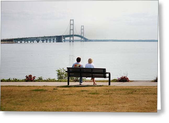 Mackinaw City Greeting Cards - Couple On Bench At The Mackinac Bridge Greeting Card by Dan Sproul