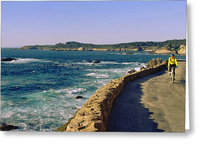 California Ocean Photography Greeting Cards - Couple Riding Bicycles Along California Greeting Card by Panoramic Images
