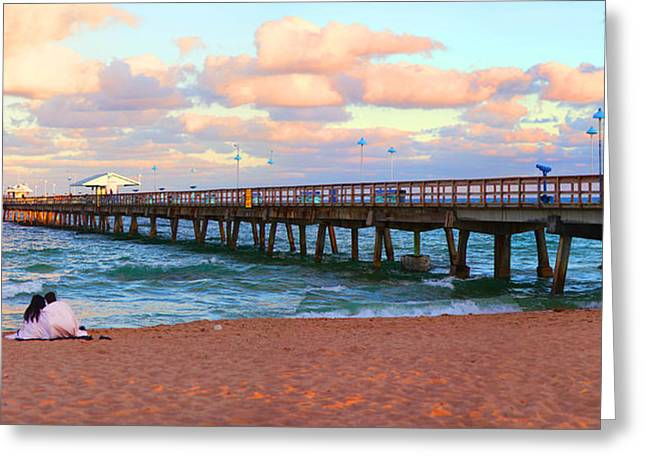 Fort Lauderdale Greeting Cards - Couple Sitting On The Beach At Sunset Greeting Card by Panoramic Images