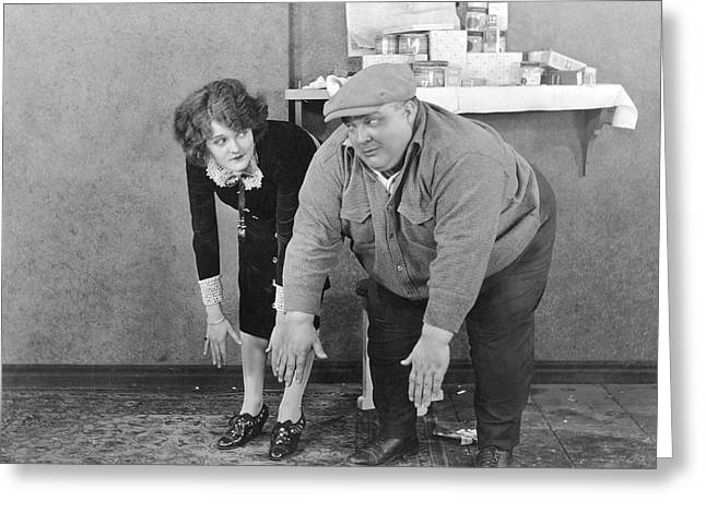 Couple Tries To Touch Toes Greeting Card by Underwood Archives
