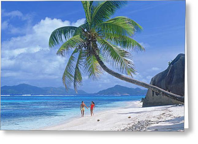 Tree In Rock Greeting Cards - Couple Walking On The Beach, Anse Greeting Card by Panoramic Images