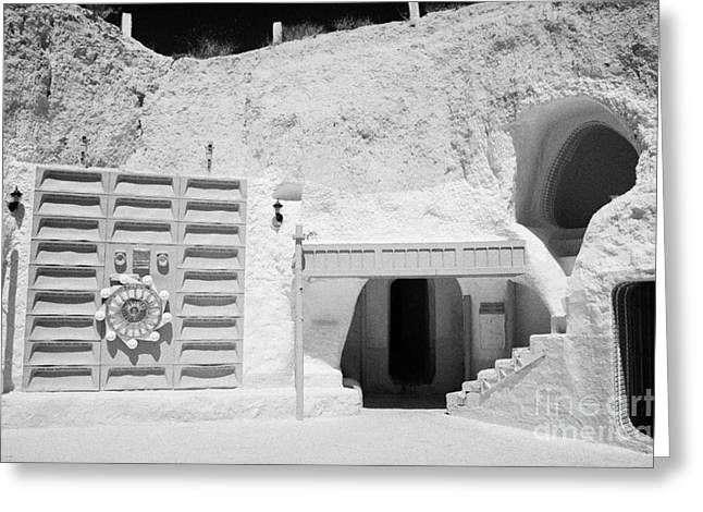 Dug Out Greeting Cards - courtyard of the Sidi Driss Hotel underground at Matmata Tunisia scene of Star Wars films with film props Greeting Card by Joe Fox