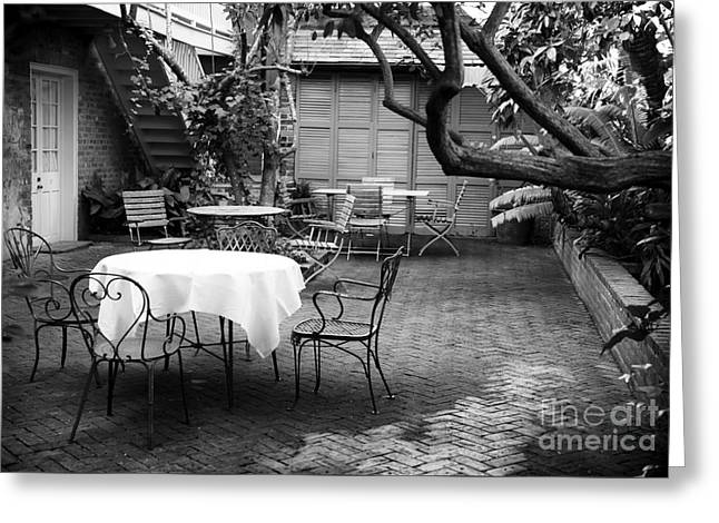 Courtyard Seating Greeting Card by John Rizzuto