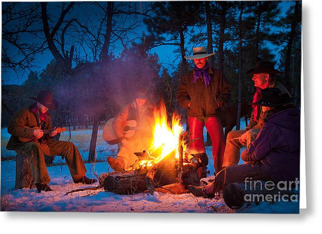 Snowy Night Greeting Cards - Cowboy Campfire Greeting Card by Inge Johnsson