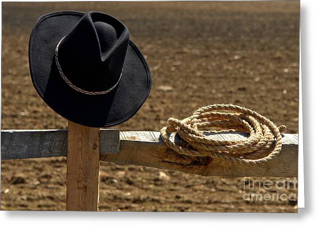 Rope Greeting Cards - Cowboy Hat and Rope on Fence Greeting Card by Olivier Le Queinec