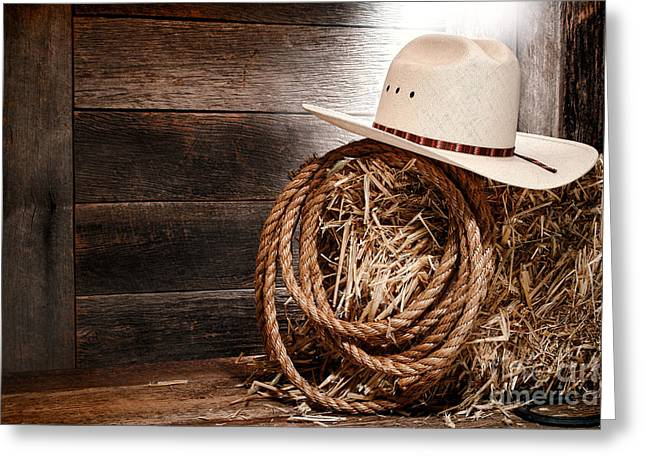 Hay Bales Greeting Cards - Cowboy Hat on Hay Bale Greeting Card by Olivier Le Queinec