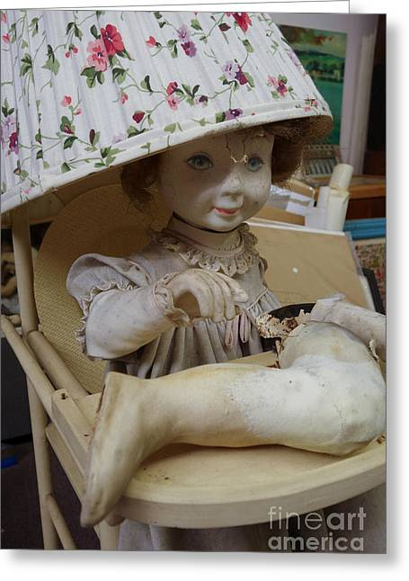 Lampshade Greeting Cards - Creepy old doll with broken leg in a high chair with a lampshade Greeting Card by Amy Cicconi