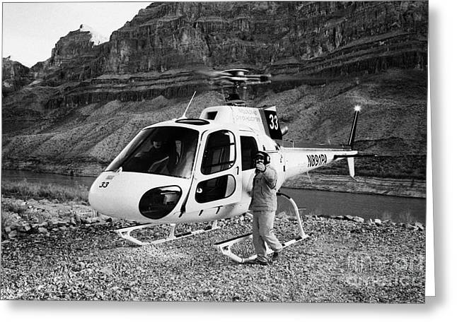 Beckon Greeting Cards - Crew Member Calling Passengers Forward For Boarding Papillon Helicopter Tours Landed On Pad Down In  Greeting Card by Joe Fox