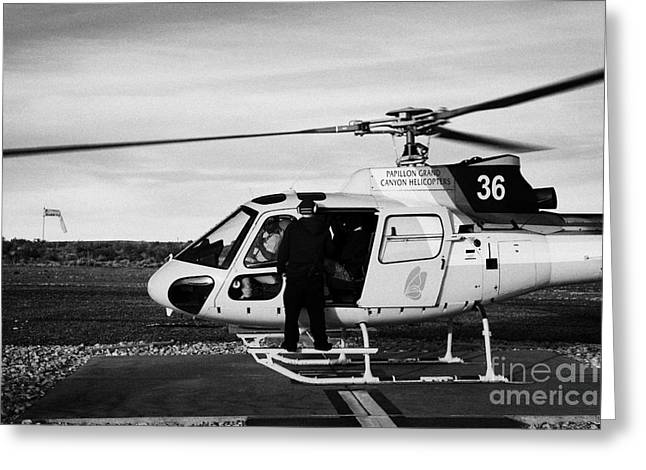 Helipad Greeting Cards - crew member checking passengers on board papillon helicopter tours on helipad at Grand canyon west a Greeting Card by Joe Fox