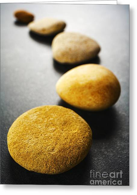 Stepping Stones Greeting Cards - Curving Line of Brown Pebbles on Dark Background Greeting Card by Colin and Linda McKie