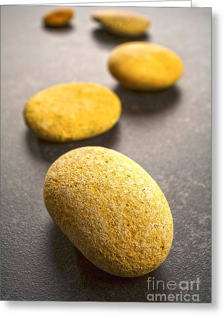 Stepping Stones Greeting Cards - Curving Line of Stones Pebbles on Dark Background Vertical Greeting Card by Colin and Linda McKie