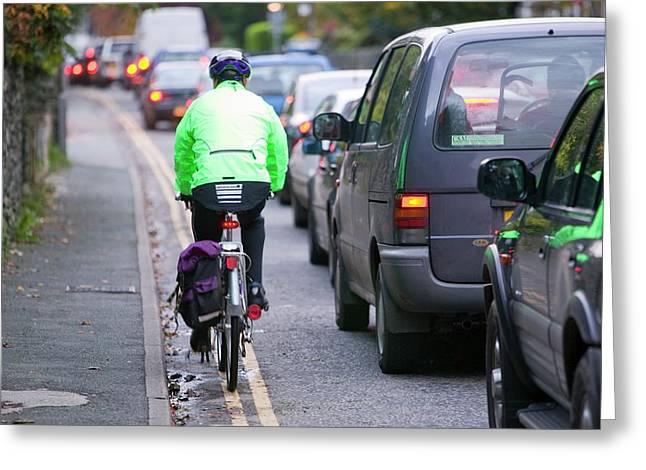 Cycling Through Traffic Jam Greeting Card by Ashley Cooper
