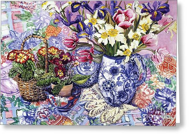 Table-cloth Greeting Cards - Daffodils Tulips and Iris in a Jacobean Blue and White Jug with Sanderson Fabric and Primroses Greeting Card by Joan Thewsey