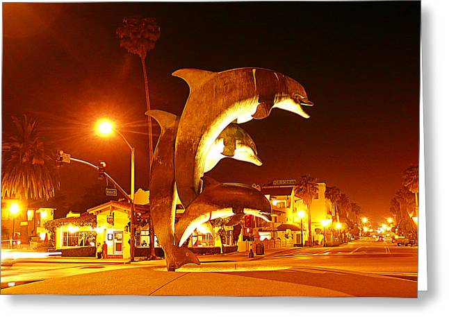Stearns Wharf Greeting Cards - Dancing Dolphins at Night Greeting Card by Ron Regalado