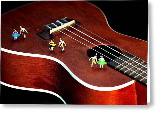 Guitar Stings Greeting Cards - Dancing party on a guitar Greeting Card by Paul Ge