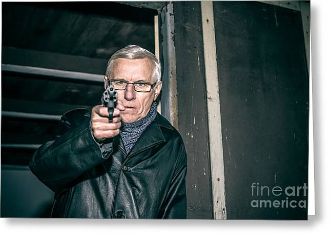 Escapees Photographs Greeting Cards - Dangerous senior aiming a gun Greeting Card by Jan Mika