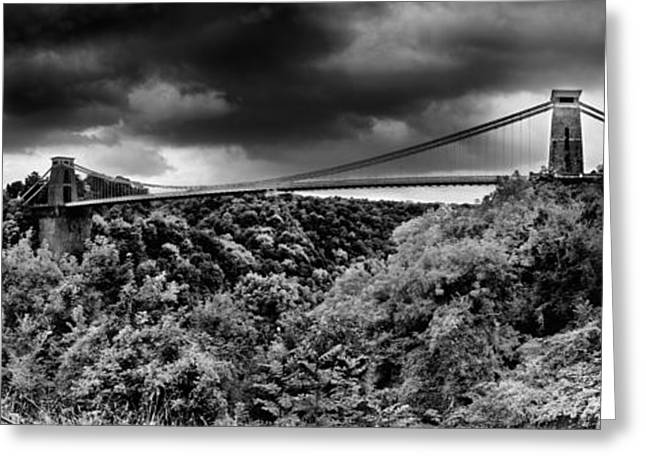 Overcast Day Greeting Cards - Dark Clouds Over A Suspension Bridge Greeting Card by Panoramic Images