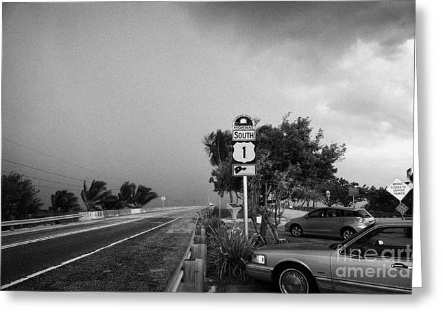 Dark Grey Greeting Cards - Dark Rain Storm Clouds Blow Over The Seven Mile Bridge Marathon Key Car Park Florida Keys Usa Greeting Card by Joe Fox