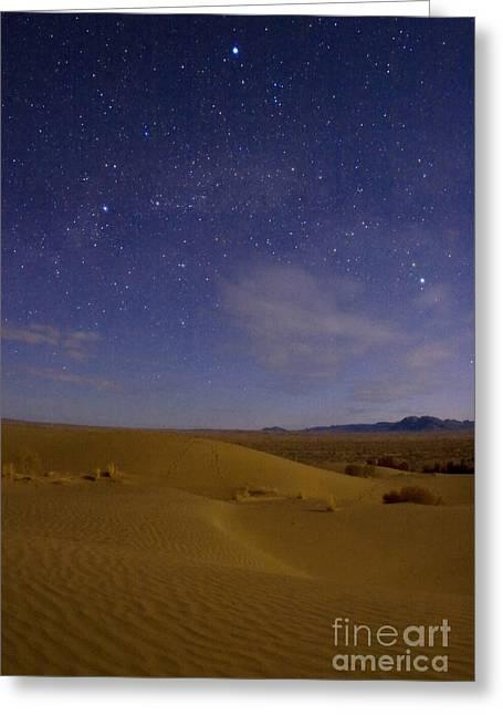 Deneb Greeting Cards - Desert In A Starry Night Greeting Card by Babak Tafreshi