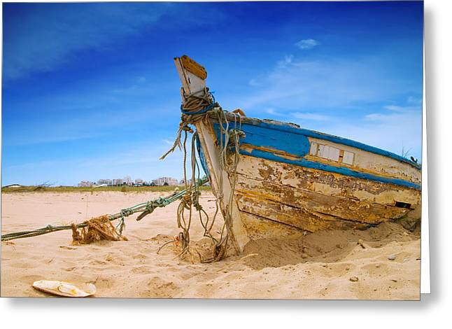 Algarve Greeting Cards - Dilapidated Boat at Ferragudo Beach Algarve Portugal Greeting Card by Amanda And Christopher Elwell