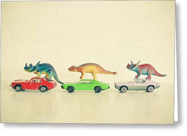 Dinosaurs Ride Cars Greeting Card by Cassia Beck
