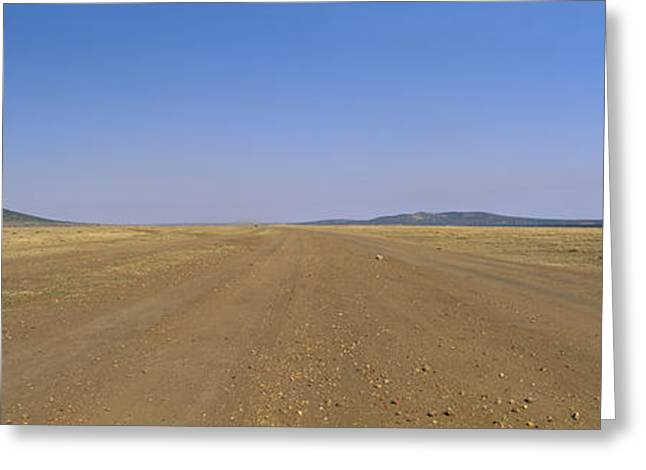 Rift Greeting Cards - Dirt Road Passing Through A Landscape Greeting Card by Panoramic Images