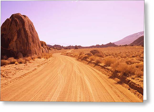 Californian Greeting Cards - Dirt Road Passing Through An Arid Greeting Card by Panoramic Images