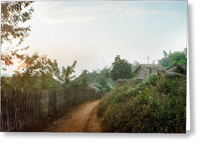Chiang Greeting Cards - Dirt Road Passing Through An Indigenous Greeting Card by Panoramic Images