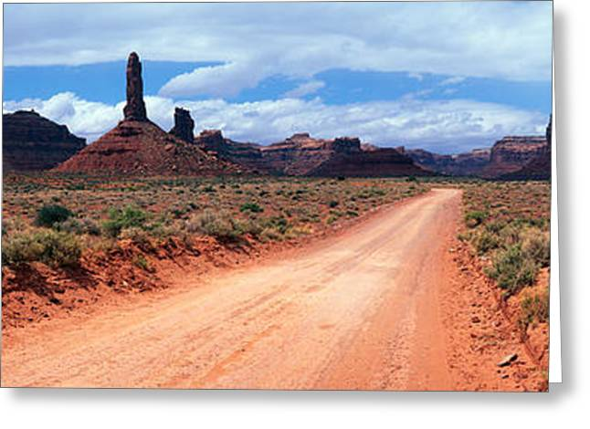 Sandstone Formation Greeting Cards - Dirt Road Through Desert Landscape Greeting Card by Panoramic Images