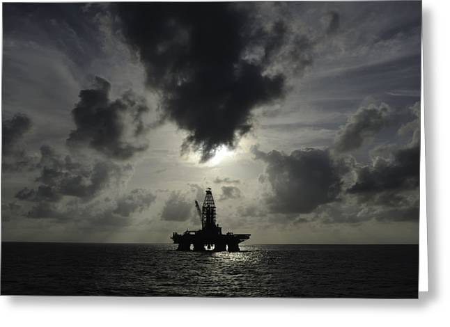 Sea Platform Greeting Cards - Distant offshore oil rig Greeting Card by Bradford Martin