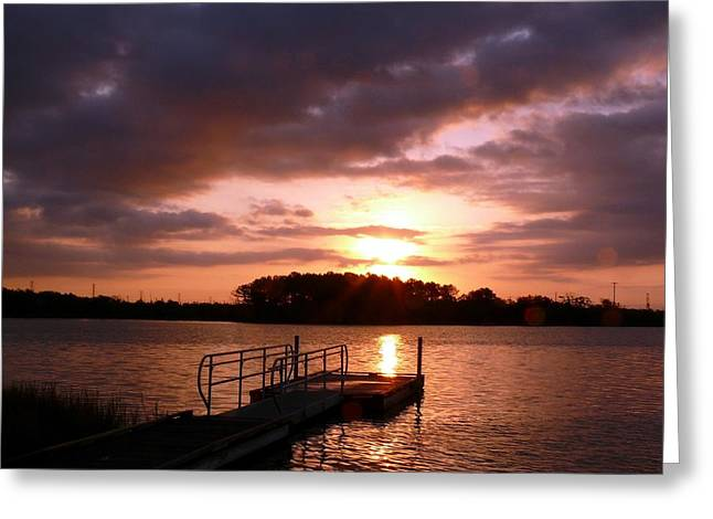 Water Reflecting At Sunset Greeting Cards - Dock at sunrise Greeting Card by Robert Brown