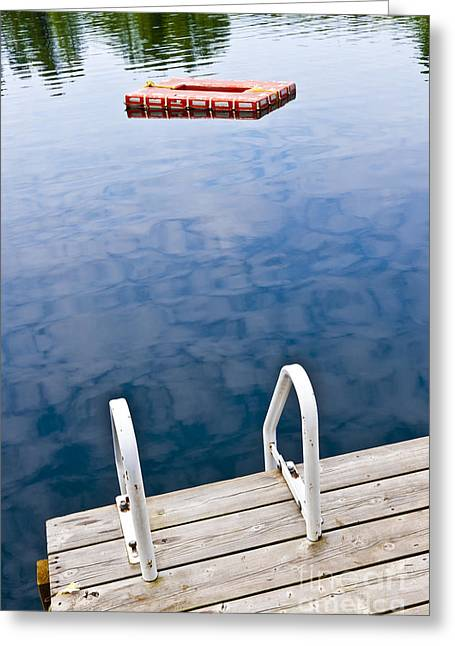 Inviting Greeting Cards - Dock on calm lake in cottage country Greeting Card by Elena Elisseeva