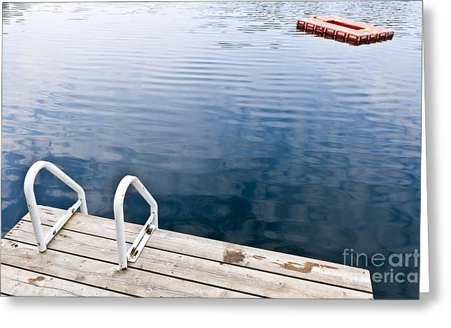 Inviting Greeting Cards - Dock on calm summer lake Greeting Card by Elena Elisseeva