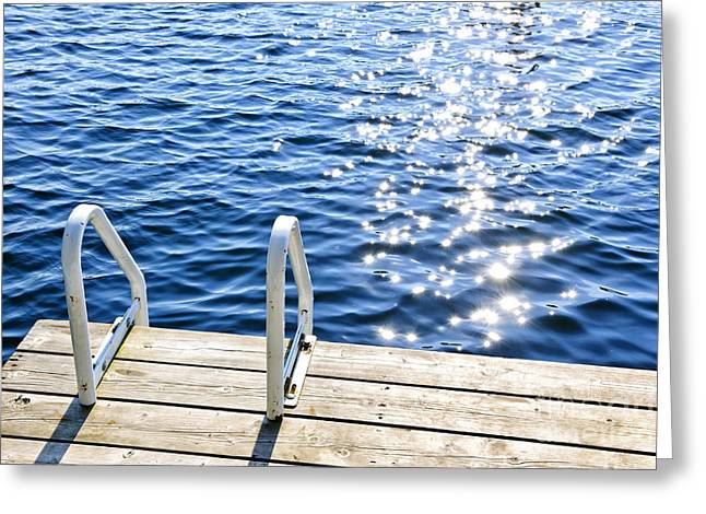 Plank Greeting Cards - Dock on summer lake with sparkling water Greeting Card by Elena Elisseeva