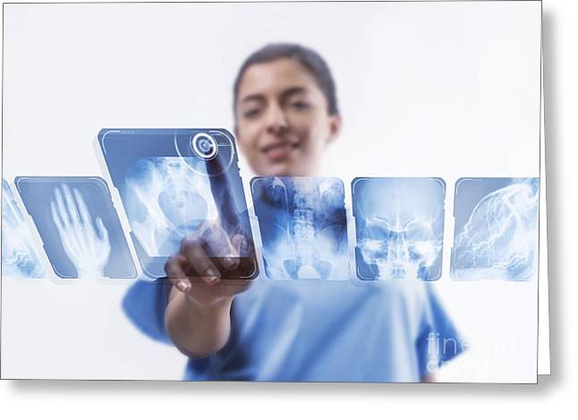 Medical X-ray Greeting Cards - Doctor Studying X-rays Greeting Card by Science Photo Library