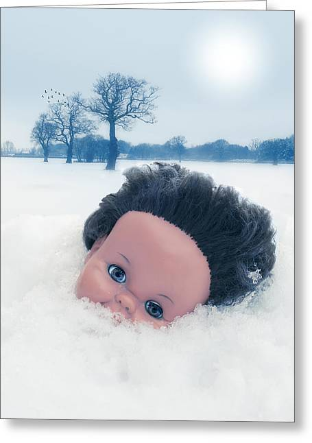 Dolls Head In Snow Greeting Card by Amanda And Christopher Elwell