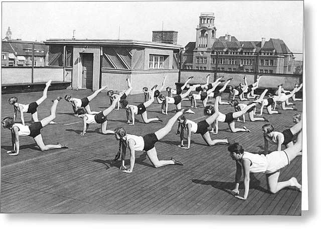 Legs Up Greeting Cards - Donkey Kick Exercising Greeting Card by Underwood Archives
