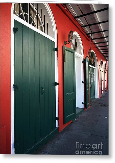 Red Buildings Greeting Cards - Doors in the Quarter Greeting Card by John Rizzuto