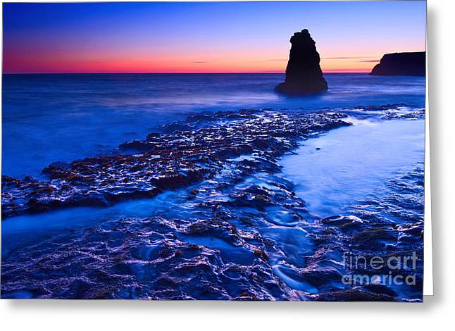 Monolith Greeting Cards - Dramatic sunset view of a sea stack in Davenport Beach Santa Cruz. Greeting Card by Jamie Pham