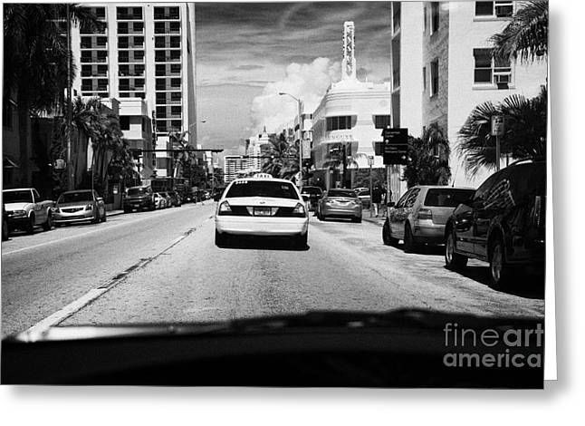 Driving Greeting Cards - Driving Along Collins Ave In Miami South Beach Following A Yellow Cab Florida Usa Greeting Card by Joe Fox