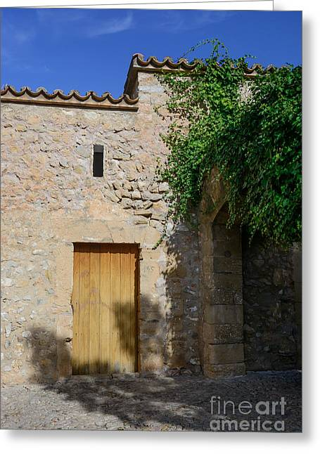 Aperture Greeting Cards - Drystone building with wooden door Greeting Card by Christina Rahm