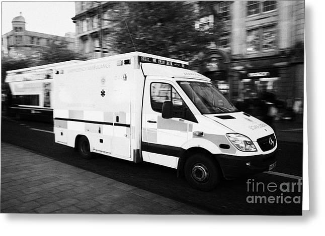 Brigade Greeting Cards - Dublin Fire Brigade Emergency Ambulance Speeds Along Oconnell Street Dublin Republic Of Ireland Greeting Card by Joe Fox
