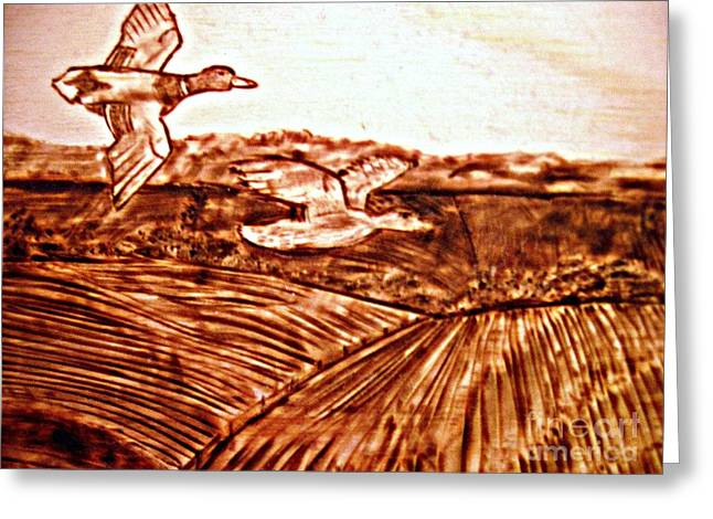 Flying Bird Pyrography Greeting Cards - Ducks Over the Field  Greeting Card by Amanda Reinier