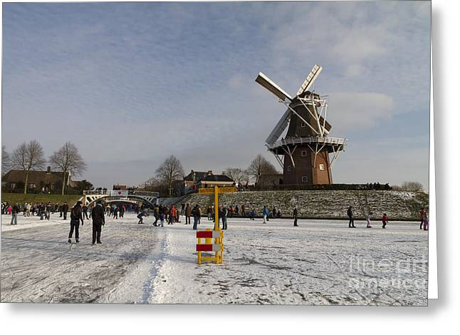 Outlook Greeting Cards - Dutch winter scene skaters and windmill at Dokkum Greeting Card by Bart De Rijk