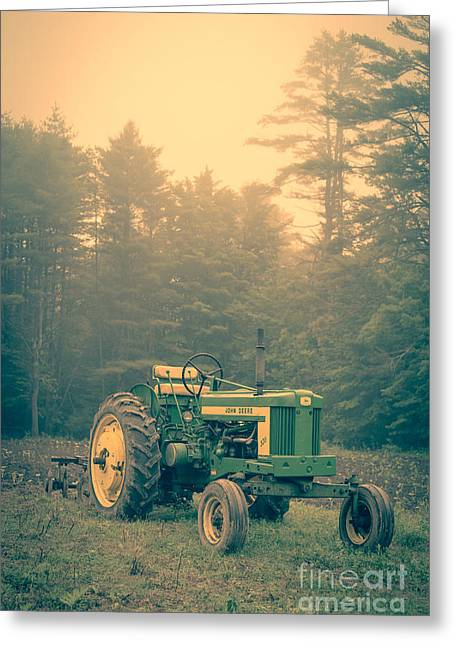Tractors Greeting Cards - Early morning tractor in farm field Greeting Card by Edward Fielding