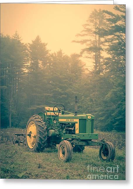 Early Morning Tractor In Farm Field Greeting Card by Edward Fielding
