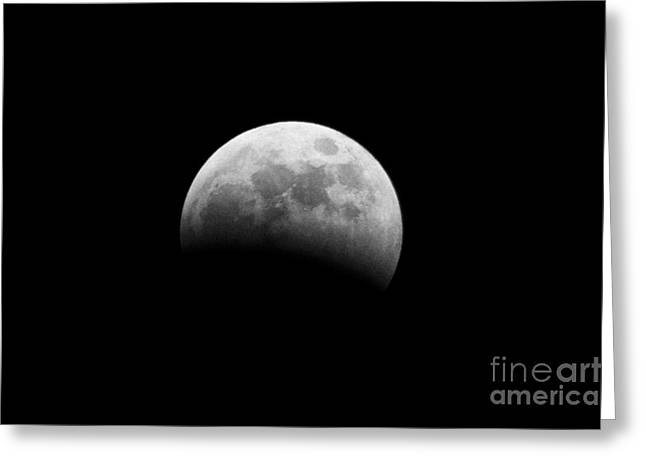 Astronomic Greeting Cards - earths shadow passes over the moon at start of a total lunar eclipse as seen from Northern Ireland in March 2007 Greeting Card by Joe Fox