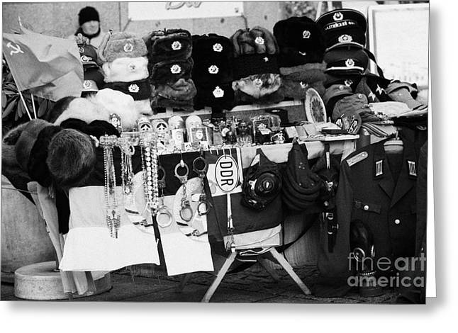 Berlin Germany Greeting Cards - east german and russian memorabilia on sale at a street stall near checkpoint charlie Berlin Germany Greeting Card by Joe Fox