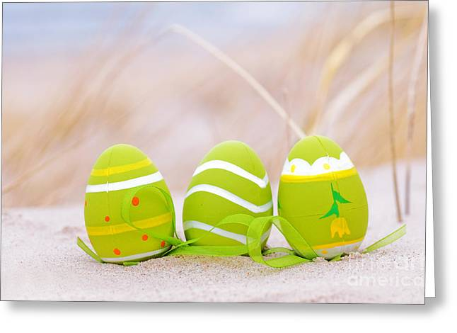 Sand Pattern Greeting Cards - Easter decorated eggs on sand Greeting Card by Michal Bednarek